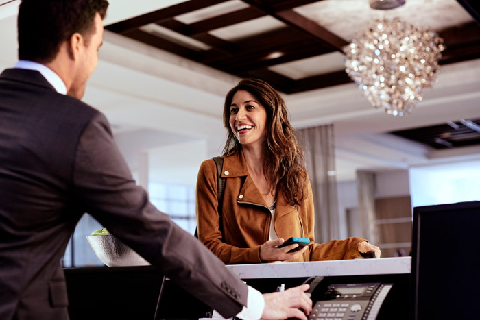 A women at a hotel reception desk
