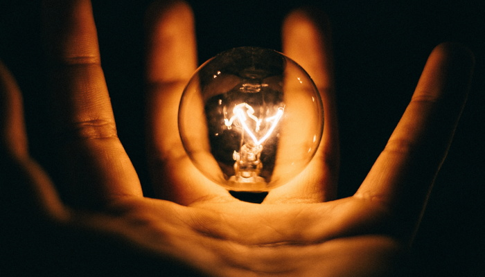 clear glass bulb on human palm - Photo by Rohan Makhecha on Unsplash