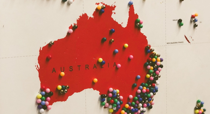 Australia map filled with pins - Photo by Jon Tyson on Unsplash