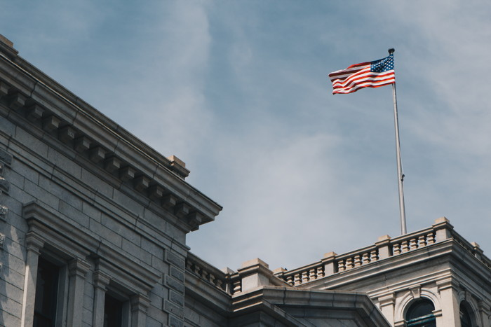 American Flag on building - Photo by Hayes Potter on Unsplash