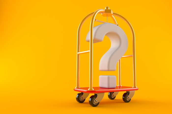 A luggage cart with a question mark