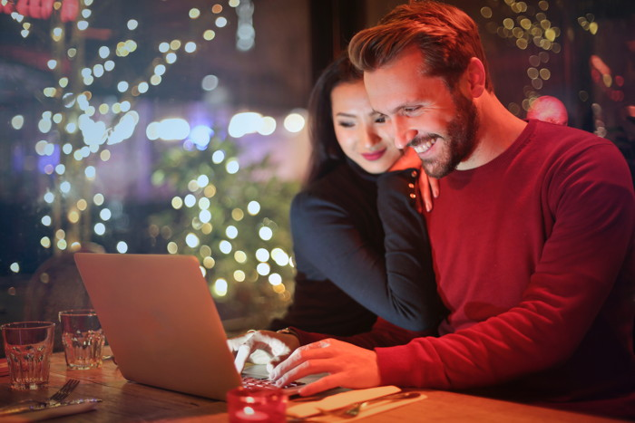 man and woman looking on silver laptop while smiling - Photo by bruce mars on Unsplash