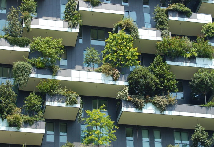 building with trees on balconies - Photo by Chris Barbalis on Unsplash