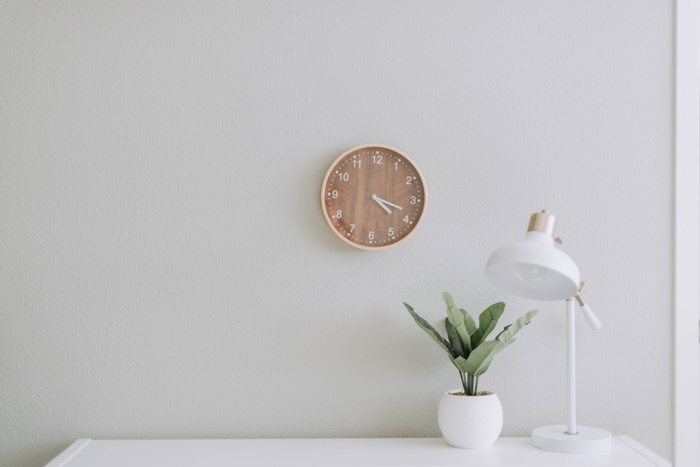 A desk and wall clock