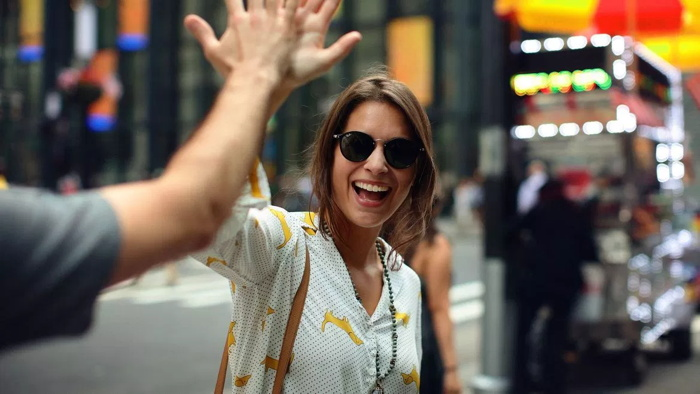 A woman high fiving