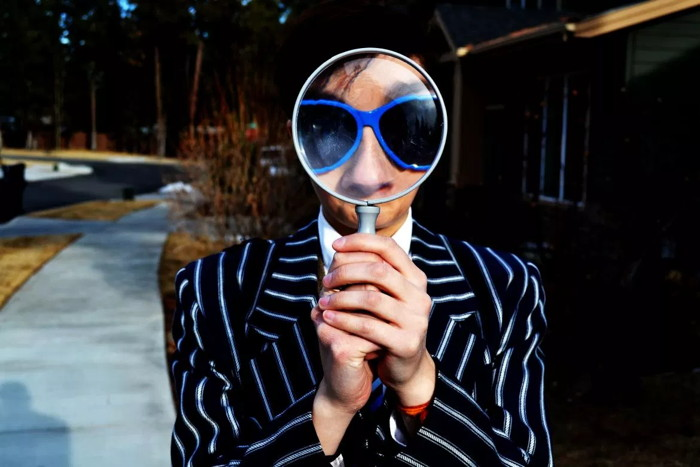 A person looking through a magnifying glass