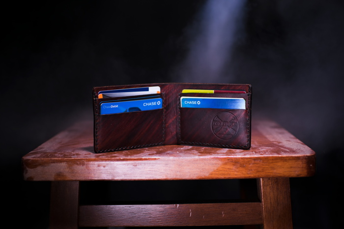 Credit cards in a wallet - Photo by Two Paddles Axe and Leatherwork on Unsplash