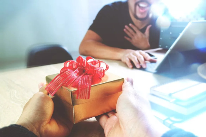 A person receiving a gift