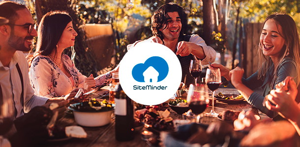 A group of people at a table and a SiteMinder logo