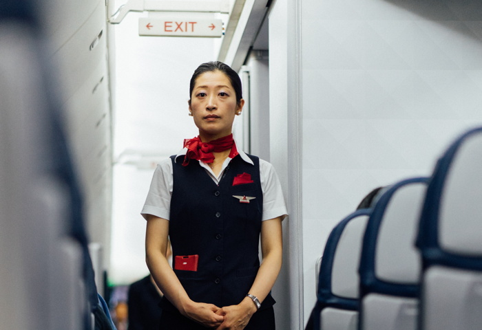 A flight attendant - Photo by Hanson Lu on Unsplash