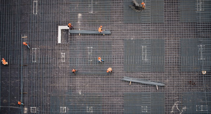 A photo of a construction site taken from a higher building - Photo by Saad Salim on Unsplash