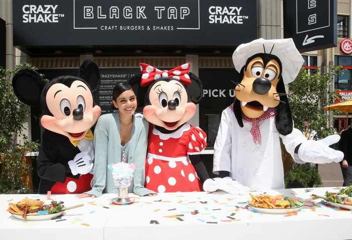 Mickey Mouse, Minnie Mouse and Goofy join actor Vanessa Hudgens to celebrate the opening of Black Tap Craft Burgers & Shakes, May 18, 2019, in the Downtown Disney District at Disneyland Resort in Anah