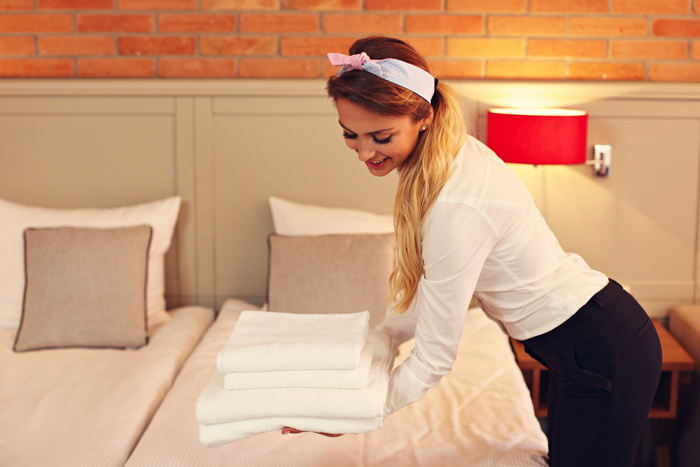 A Housekeeper in a hotel room