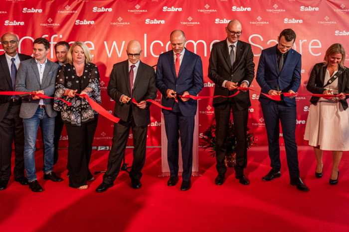 Key Sabre executives were present for a ribbon-cutting ceremony at the site that will house Sabre Poland's new global development center location. Among those pictured are Sundar Narasimhan, SVP and p