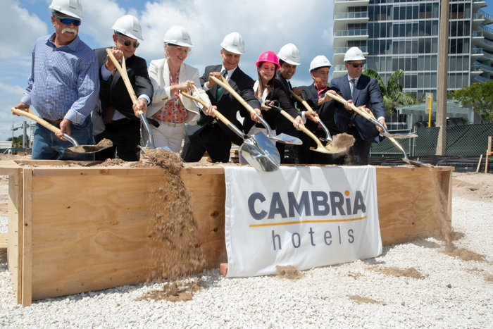 Owners and developers Jai and Jessica Motwani of Hotel Motel Inc. join representatives from Choice Hotels, Marquis Bank, and Seawood Builders to break ground on the Cambria Hotel Fort Lauderdale Beach