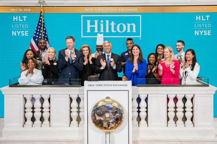 Hilton's CEO and Team Members Ring Opening Bell at New York Stock Exchange in Celebration of its 100th Anniversary