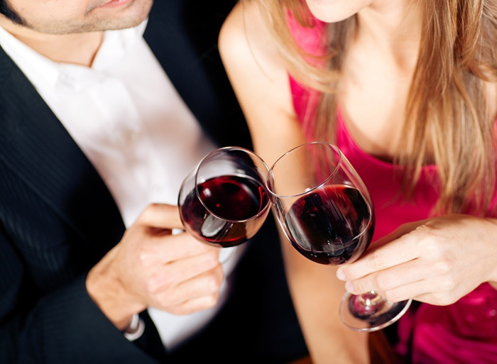 A couple toasting with wine glasses