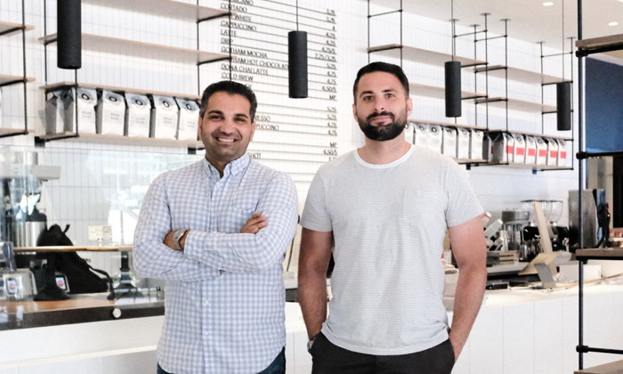 For Five Coffee founders Stefanos Vouvoudakis and Tom Tsiplakos stand inside the new 1 Liberty Plaza cafe