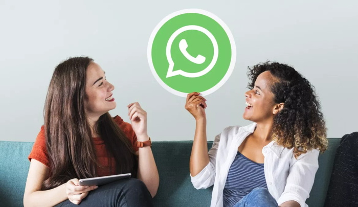 The women and a Whatsapp bubble between them