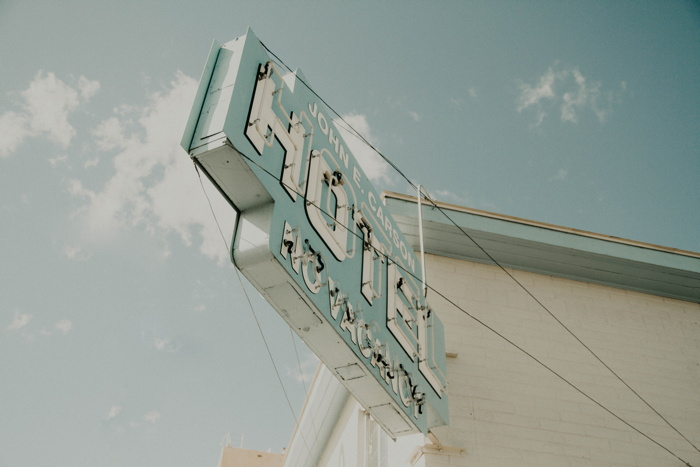 Hotel signage mounted on white building - Photo by NeONBRAND on Unsplash