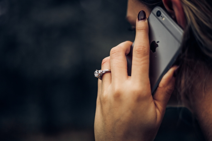 woman talking on the phone - Photo by Taylor Grote on Unsplash