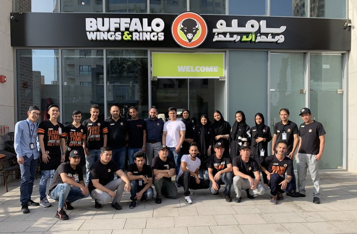 Group picture for Buffalo Wings & Rings Employees in Emaar Square Jeddah