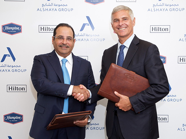 Mohammed Alshaya, Executive Chairman of Alshaya Group (Left) and Chris Nassetta, President and CEO of Hilton (Right) at the signing ceremony in London.
