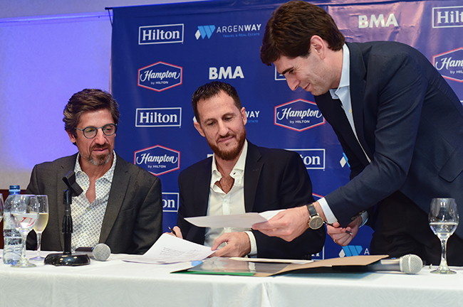 Image from Hampton by Hilton Rosario signing ceremony