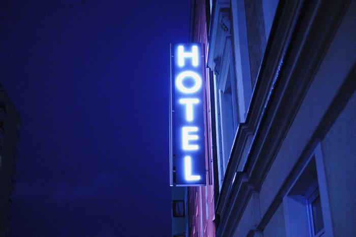 Hotel LED signage - Photo by Ph B on Unsplash