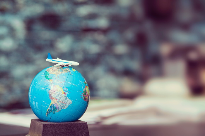 plane toy over a world globe - Photo by Frank Vex on Unsplash