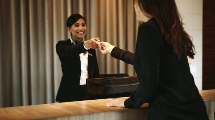 Person checking in at a hotel
