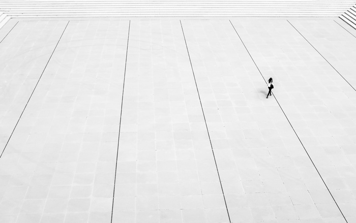 A solitarty person in a plaza
