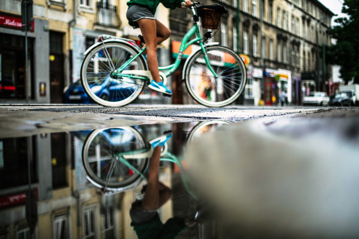 person riding on teal bicycle - Photo by Erik Witsoe on Unsplash
