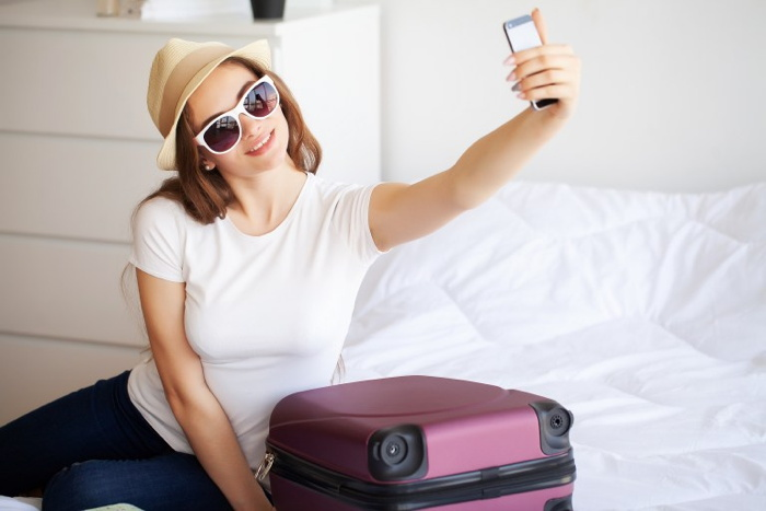 A woman taking a selfie in a hotel room