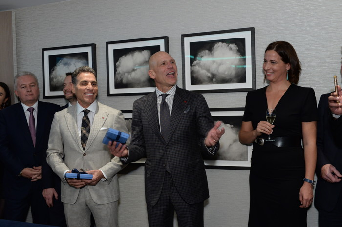 Celebrating with private aviation leaders at an opening reception were Flexjet Chairman Kenn Ricci (left), Flexjet CEO Michael Silvestro and Flexjet European Managing Director Marine Eugène (right).