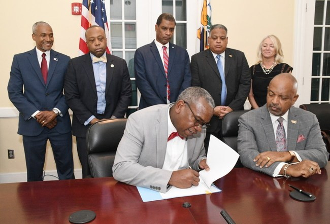 (Front row): Hon. Albert Bryan, Jr., Governor of the U.S. Virgin Islands alongside Lt. Governor Tregenza A. Roach, Esq. (Back row, left to right) Kamal I. Latham, USVIEDA CEO; Kirk Callwood, Commissioner of the Department of Finance; Hon. Kurt Vialet, Senator of the Legislature; Joseph Boschulte, Commissioner of Tourism; and Lisa Hamilton, President of the USVI Hotel & Tourism Association.
