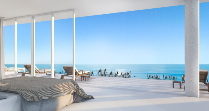 A hotel room overlooking a beach