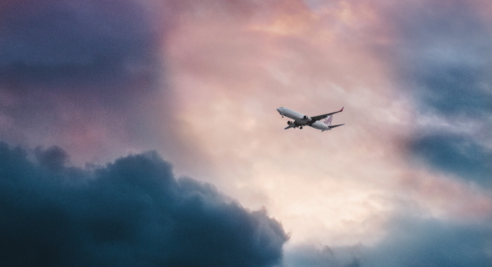 Airplane on a twilight sky - Photo by Leio McLaren (@leiomclaren) on Unsplash