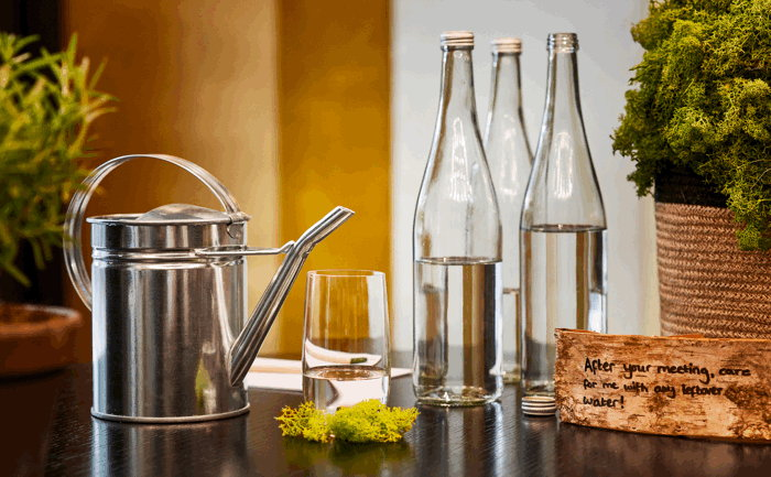 Reusable glass water bottles at Hyatt Regency Amsterdam