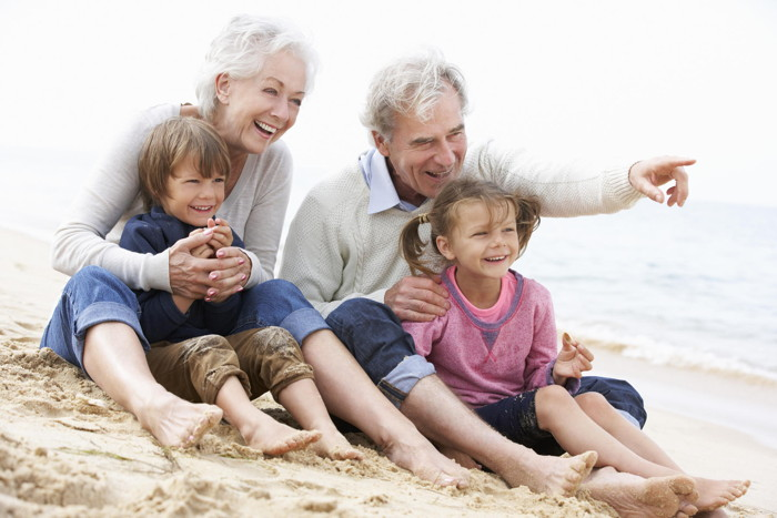 Grandparents with grandkids on a beach