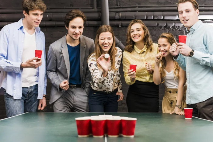 A group of people playing pong