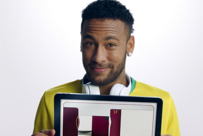 Neymar holding a tablet