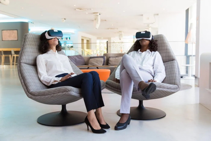 Two people using VR headsets