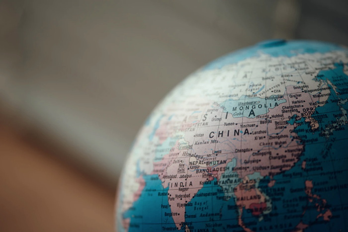 close up photo of blue desk globe - Unsplash