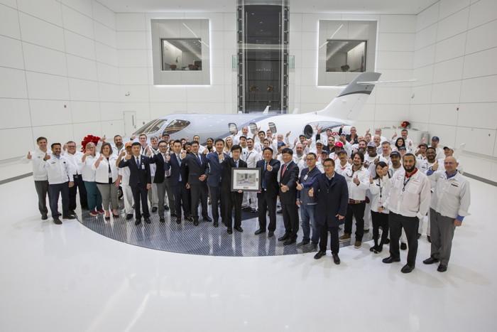 Honda Aircraft Company employees in front of a HondaJet Elite