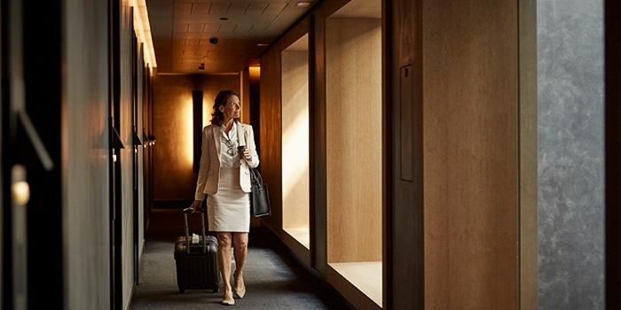 A woman in a hotel corridor