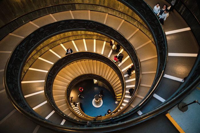 People on spiral staircase - Unsplash
