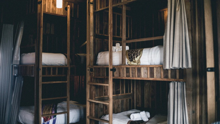 brown wooden bunk beds - Unsplash