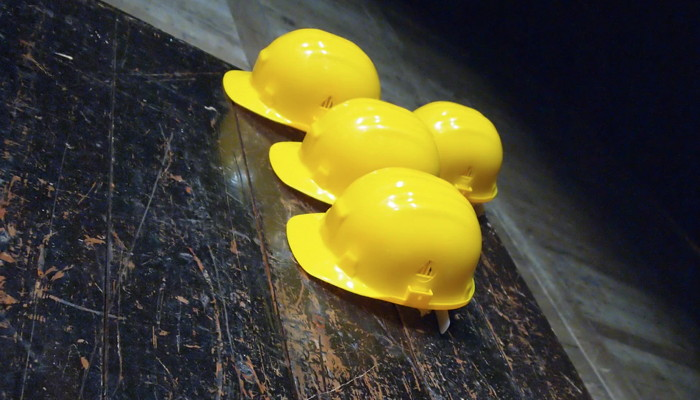yellow hard hats on gray surface - Unsplash