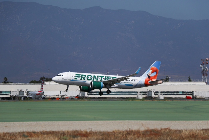 Frontier airplane during takeoff